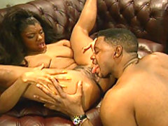 A pretty black model is seen to by a buff brown man
