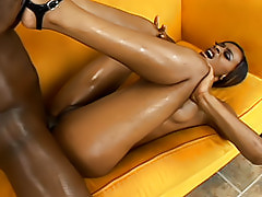 Divine's juicy black ass is oiled up before her soaking wet pussy is spread open for some hard dark meat