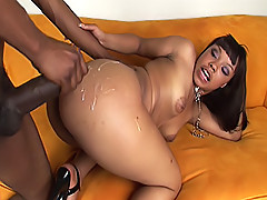 This black chick's big bubble butt gets painted with hot cum